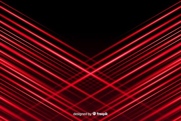 Rote lichter, die mit schwarzem hintergrund sich kreuzen