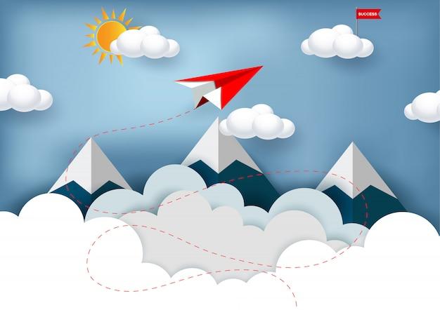 Rote papierfläche fliegen zum ziel der roten fahne auf wolke beim fliegen über berge.
