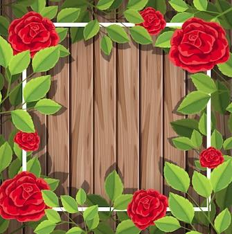 Rote rosen auf hölzernem hintergrund