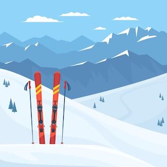 Rote skiausrüstung im skigebiet.