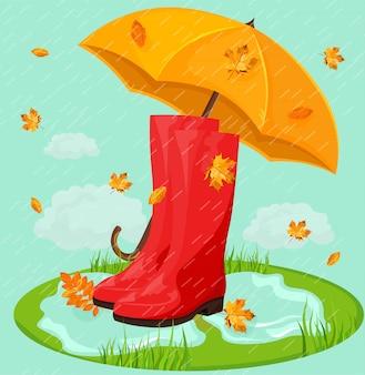 Rote stiefel im regen und regenschirm