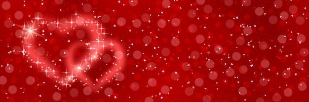 Rote unscharfe bannerschablone zum valentinstag. roter unscharfer hintergrund mit herzen und lichteffekten