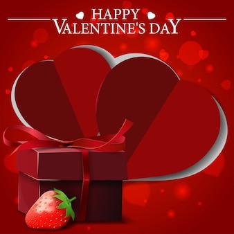 Rote valentinstaggrußkarte mit geschenk und erdbeere