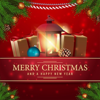 Rote weihnachtskarte mit weihnachtsgeschenken und antiker lampe