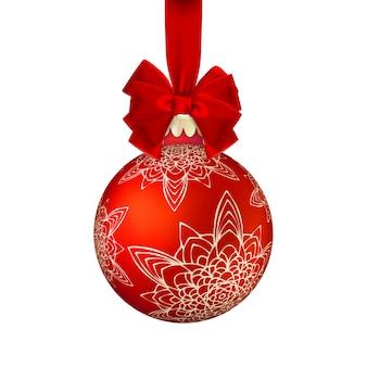 Rote weihnachtskugel mit schleife.