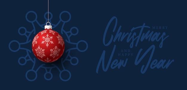 Rote weihnachtskugel und quarantäne coronavirus gefahr