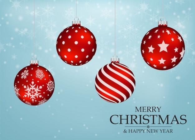 Rote weihnachtskugeln mit schneeflockenhintergrund
