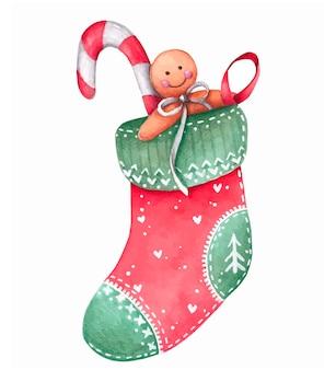 Rote weihnachtssocke mit lebkuchen und süßigkeiten