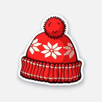 Rote wintermütze mit pompon- und schneeflockenmuster vektorillustration
