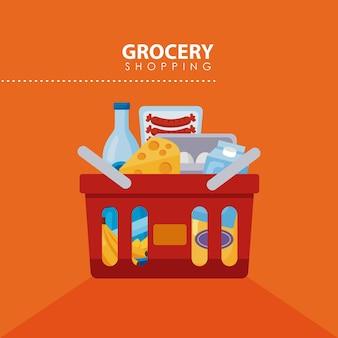 Roter einkaufskorb mit lebensmitteln