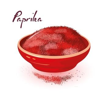 Roter paprikapulver befindet sich in einer keramikschale. gewürz, gewürz, zusatz aus getrocknetem paprika.