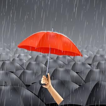 Roter regenschirm unter regen