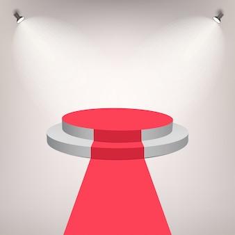 Roter teppich auf einem bühnenpodest für preis mit lichteffekt