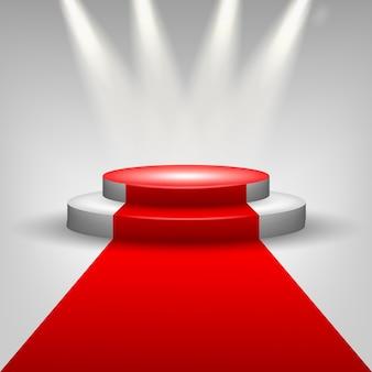 Roter teppich zur podiumsbühne mit scheinwerfern