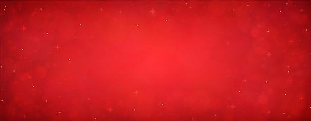 Roter weihnachtsglitterhintergrund mit sternen. festlich leuchtende unscharfe textur.