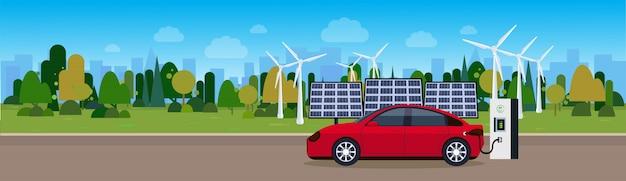 Rotes auto, das an den elektrischen stations-wind-trurbines und am sonnenkollektor-batterie-hintergrund eco freundliches vechicle-konzept auflädt