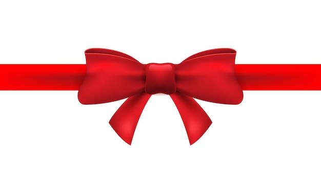 Rotes band mit roter schleife auf weißem hintergrund. isolierte bogendekoration für weihnachtsgeschenk.