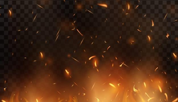 Rotes feuer funken fliegen hoch. brennende leuchtende partikel. feuerflamme mit funken in der luft über einer dunklen nacht. feuersturm textur. isoliert auf einem schwarzen transparenten hintergrund
