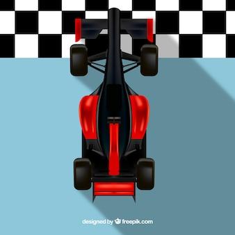 Rotes formel 1-rennauto, das ziellinie kreuzt