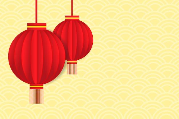 Rotes laternenpapier schnitt design auf gelbem abstraktem hintergrund.