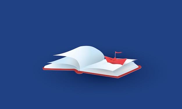 Rotes origami-boot auf dem buch kreative idee konzeptinspirationsgeschäft