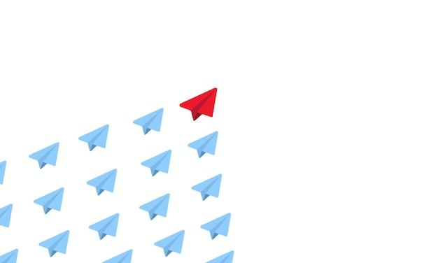 Rotes papierflugzeug als führer unter den blauen flugzeugen