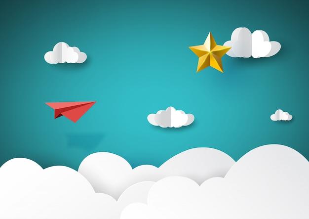 Rotes papierflugzeug, das zur goldenen sternpapierkunstart fliegt.