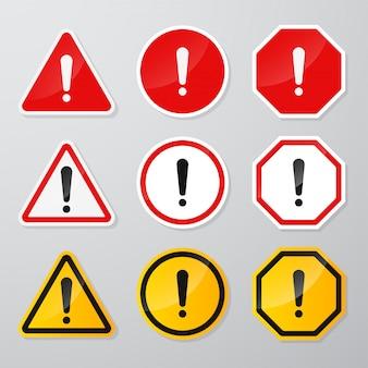 Rotes und schwarzes warnschild mit dem ausrufezeichen in der mitte