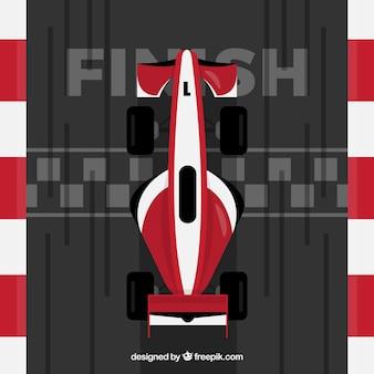 Rotes und weißes f1 rennauto kreuzt ziellinie