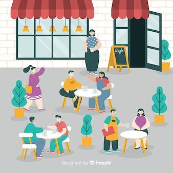 Rudel leute, die in einem café sitzen