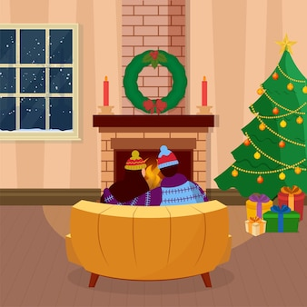 Rückansicht des paares, das am sofa vor dem kamin sitzt