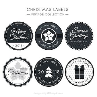 Runde graue weihnachtsabzeichen im vintage-stil