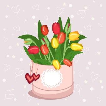 Runde schachtel mit aufkleber für text tulpen herzen und umschlag