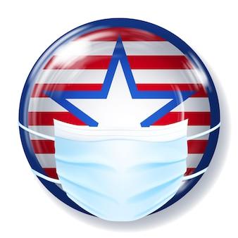 Runder glasknopf in den farben der usa-flagge mit einer medizinischen einwegmaske zum schutz des coronavirus