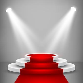 Rundes bühnenpodest mit licht. festliche podiumszene mit rotem teppich