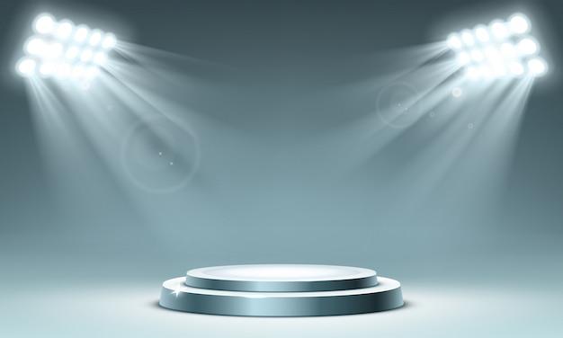 Rundes podium mit scheinwerfern beleuchtet