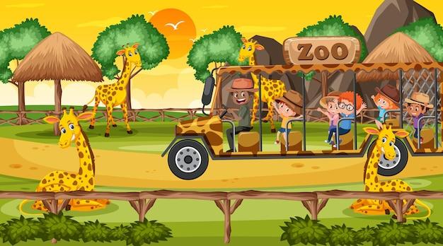 Safari bei sonnenuntergang mit vielen kindern, die eine giraffengruppe beobachten