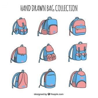 Sammlung blaue und rosafarbene rucksäcke