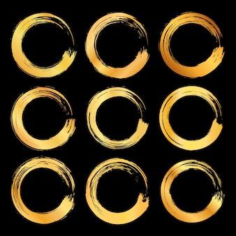 Sammlung des abstrakten goldenen pinselstrichkreisrahmens