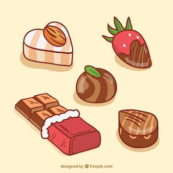 Sammlung schokoladenbonbons und -stange