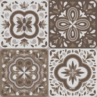 Sammlung von 4 keramikfliesen im vintage-stil mit kratzern, pastellfarbpalette.