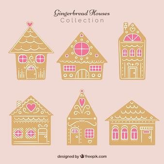 Sammlung von lebkuchenhäusern mit rosa fenstern