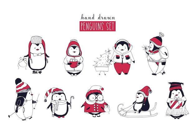 Sammlung von niedlichen pinguinen, die verschiedene winterkleidung und hüte tragen, die auf weiß lokalisiert werden