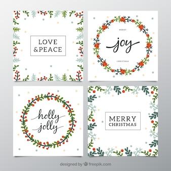 Sammlung von postkarten mit weihnachtskränzen und blumen