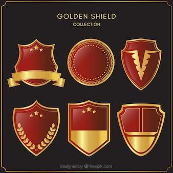 Sammlung von roten und goldenen schilde