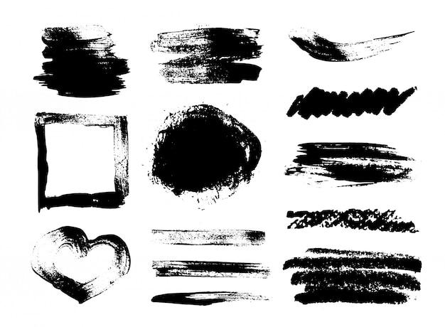 Sammlung von schmutzpinselstrichen, herzförmiger rahmen auf weißem hintergrund. einstellen