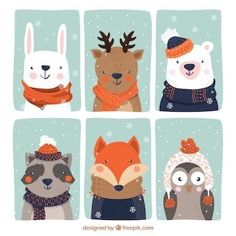 Sammlung von sechs schönen tieren mit winterkleidung