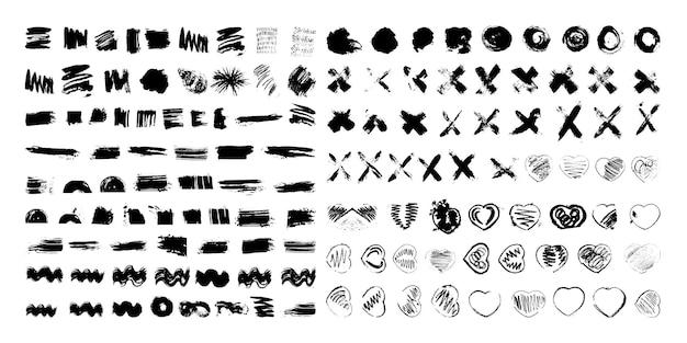 Sammlung von strukturierten klecksen und pinseln