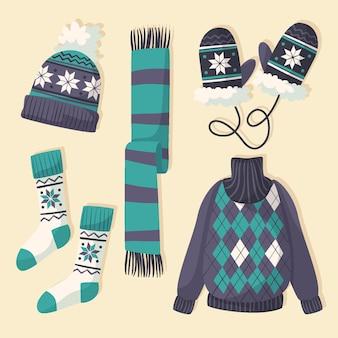 Sammlung von winterkleidung und essentials