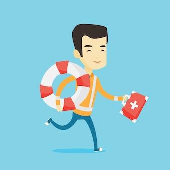 Sanitäter läuft mit erste-hilfe-box.